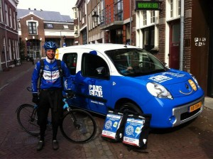 """A picture of our solar powered electric car with messenger Gijs"""